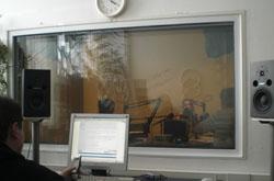 P.V. Nozdracheva at the microphone in the studio