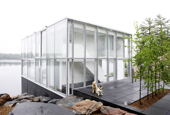 A photographer's studio over a boathouse on Stony Lake is a re-imagination of the archetypal glass house in a landscape in the Canadian Shield. A continuation of thinking about this architectural ambition, the central concept of the house is reconceived through a contemporary lens of sustainability, program, site and amenity. The compelling qualities of simple, open spaces; interior and exterior unity and material clarity are transformed to enhance the environmental and programmatic performance of the building, creating architecture of both iconic resonance and innovative context–driven design.