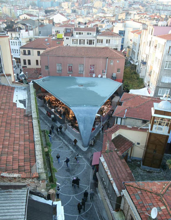 Located in one of Istanbul's most populated and diverse neighborhoods, Besiktas is an eclectic area with a village-like atmosphere that is in the process of urban renewal. The Besiktas Fish Market is located on a triangular site. It is an iconic venue where many locals and visitors buy fresh fish daily. The construction of the old fish market was in very poor shape and needed to be replaced.